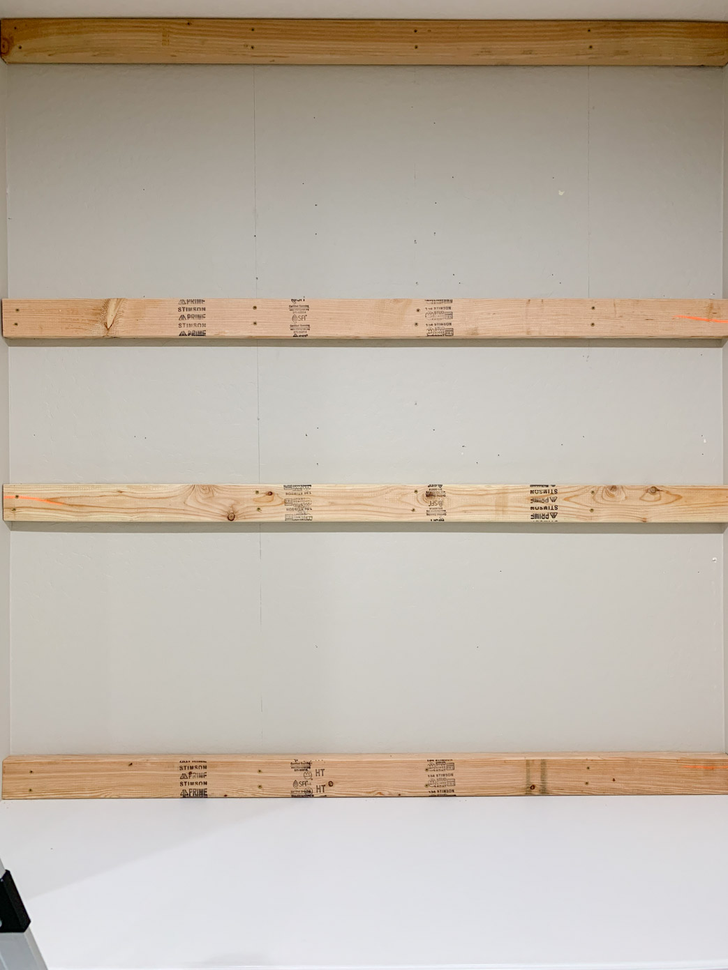 4 pieces of horizontal wood on a wall