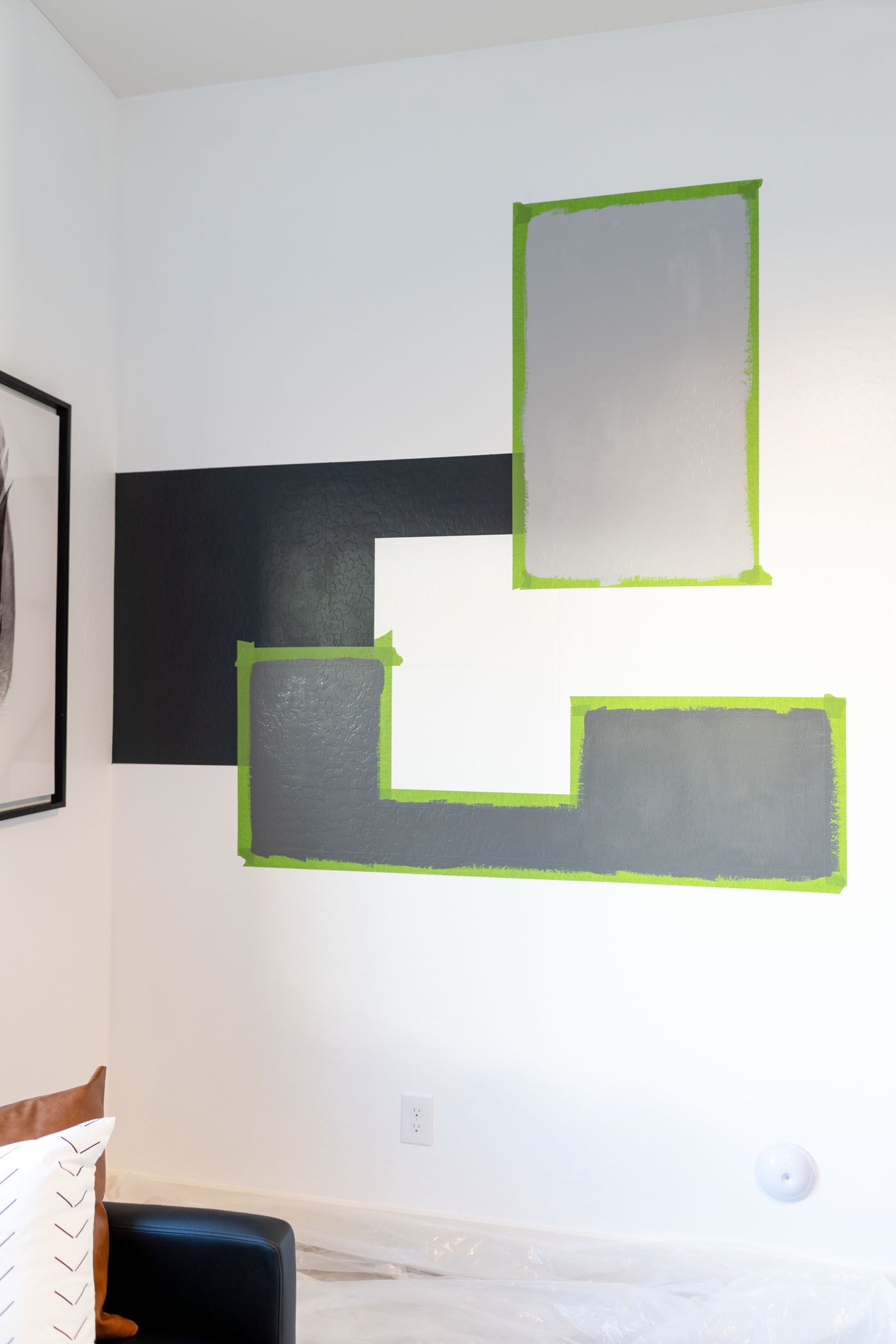 Black, light gray and dark gray sections of the DIY color block accent wall.