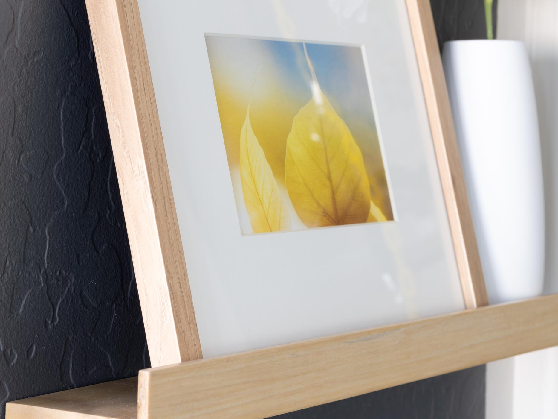 wooden shelf and picture frame