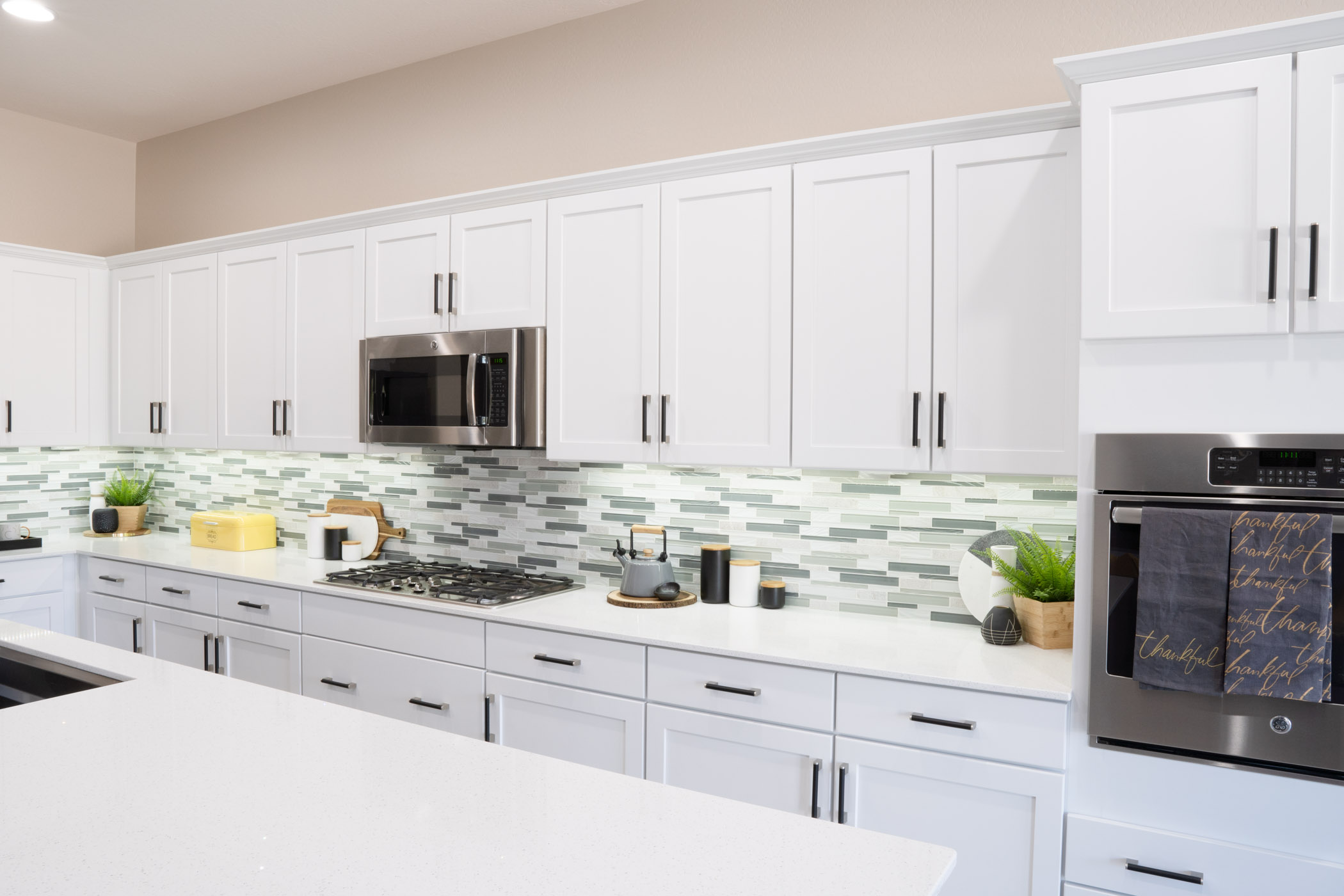 kitchen with white cabinets and black pulls