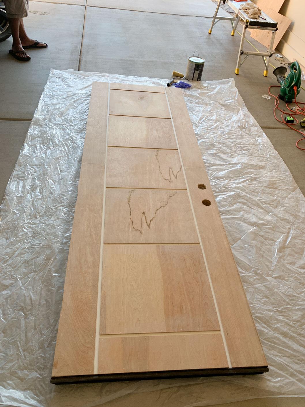 Natural wood panels on door.