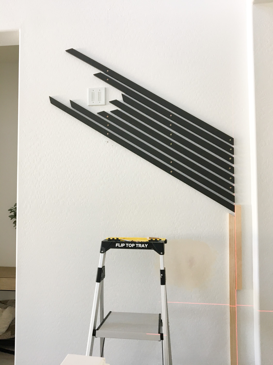 Diagonal wood slats painted black