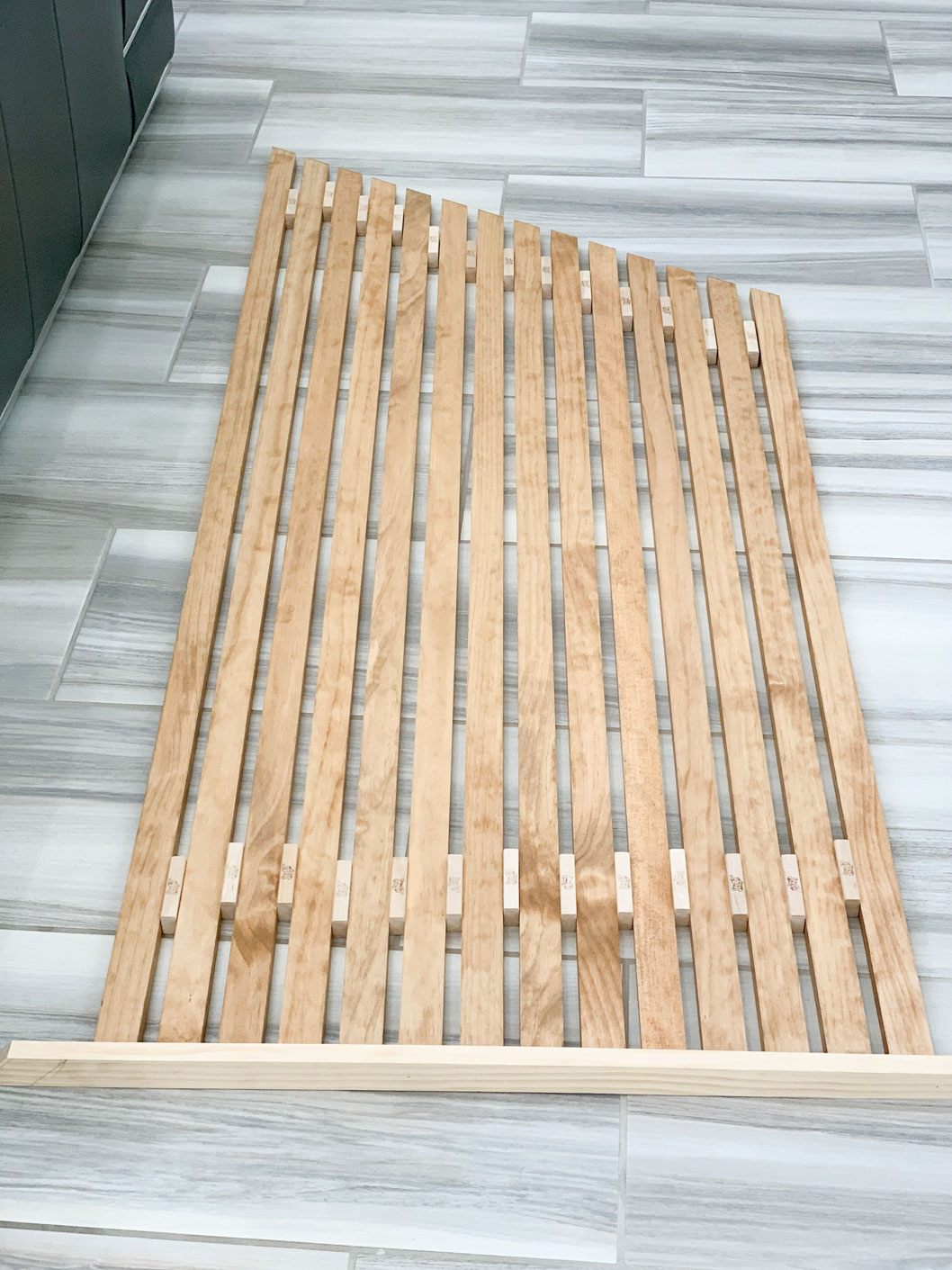 Vertical wood slats stained brown.