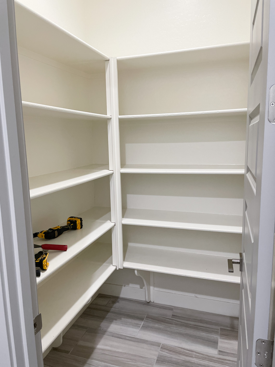 a picture of a pantry with shelves