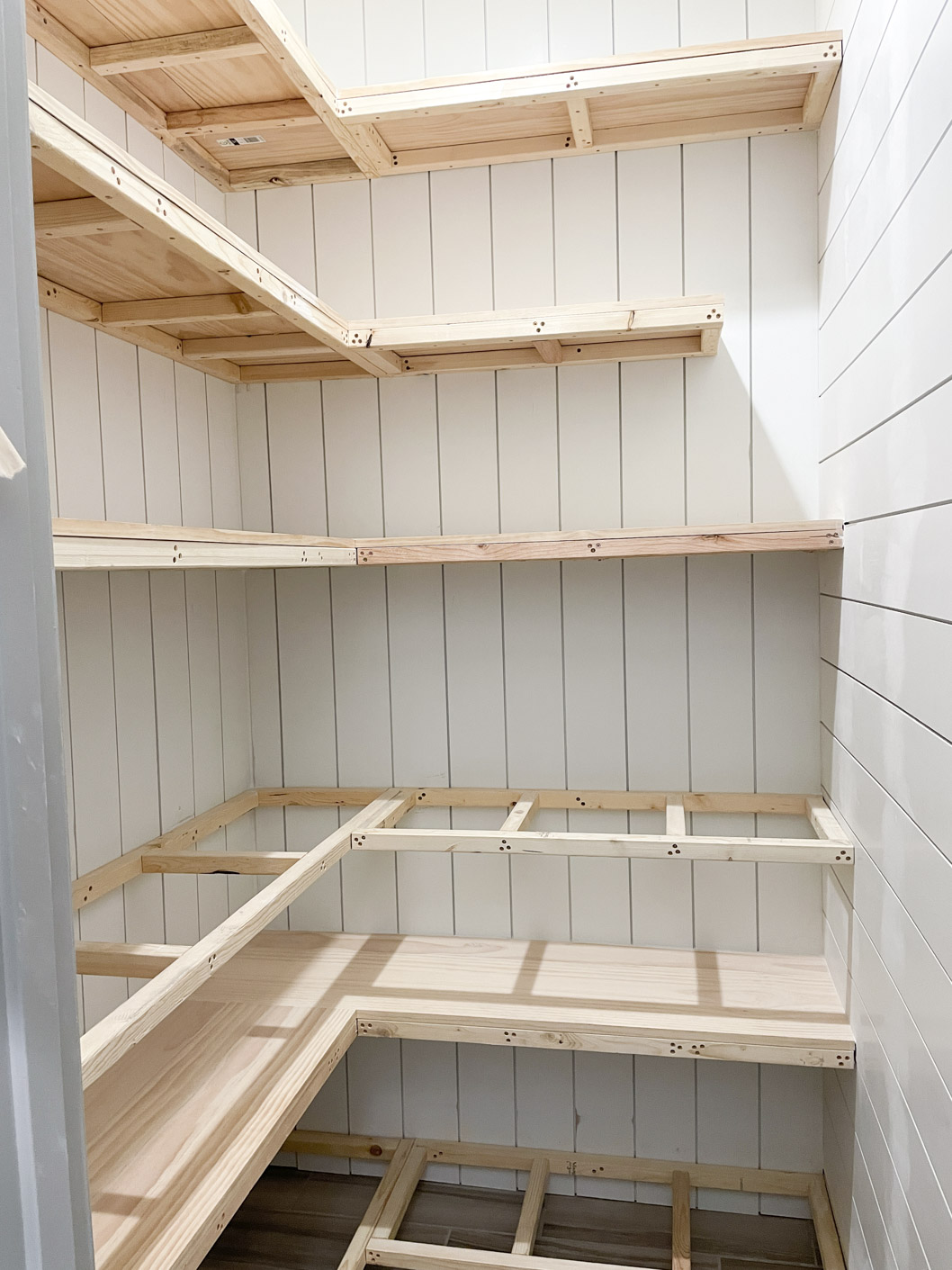 a picture showing white shiplap walls and shelves
