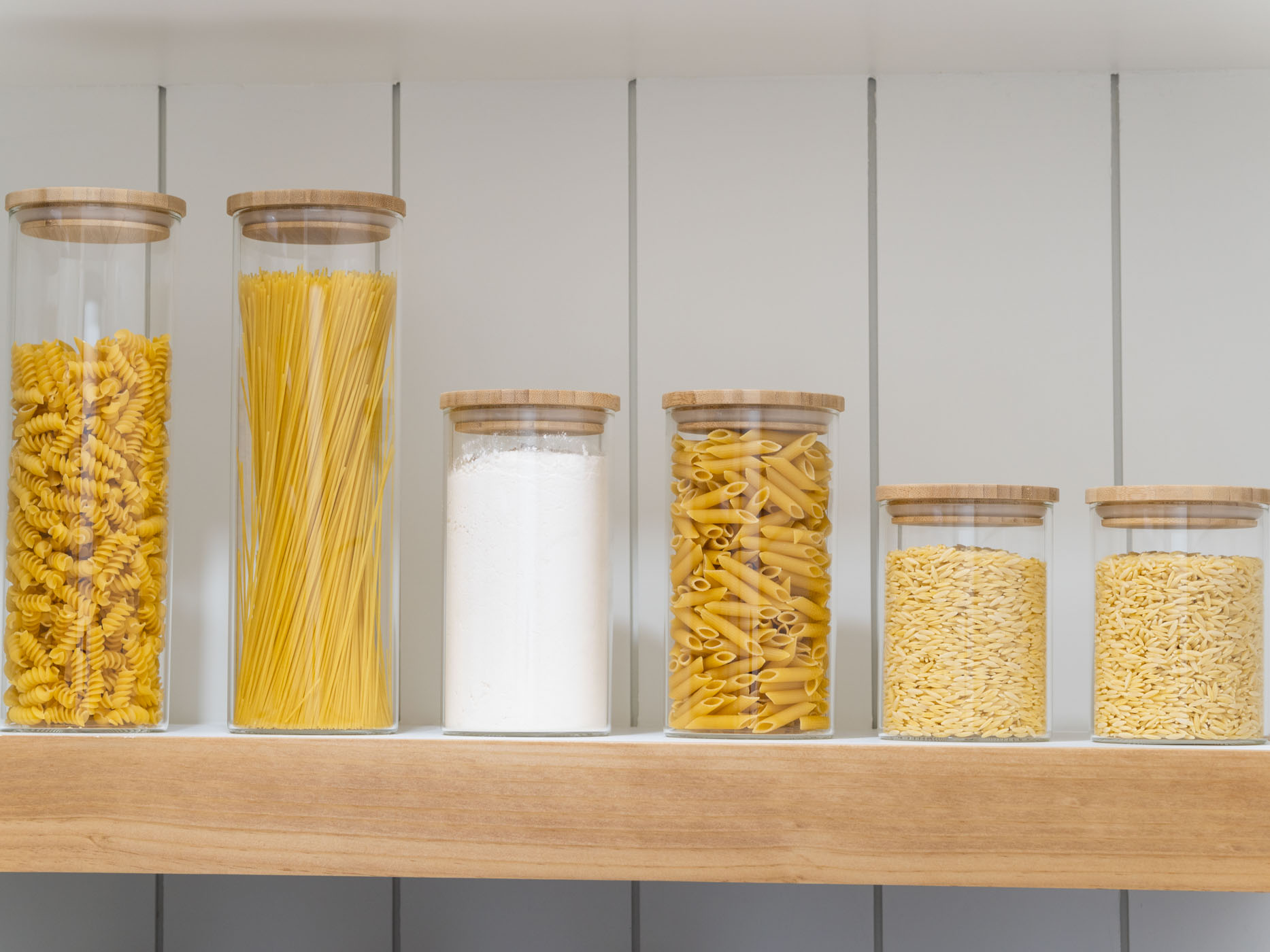 a picture showing 6 glass storage jars with bamboo lids