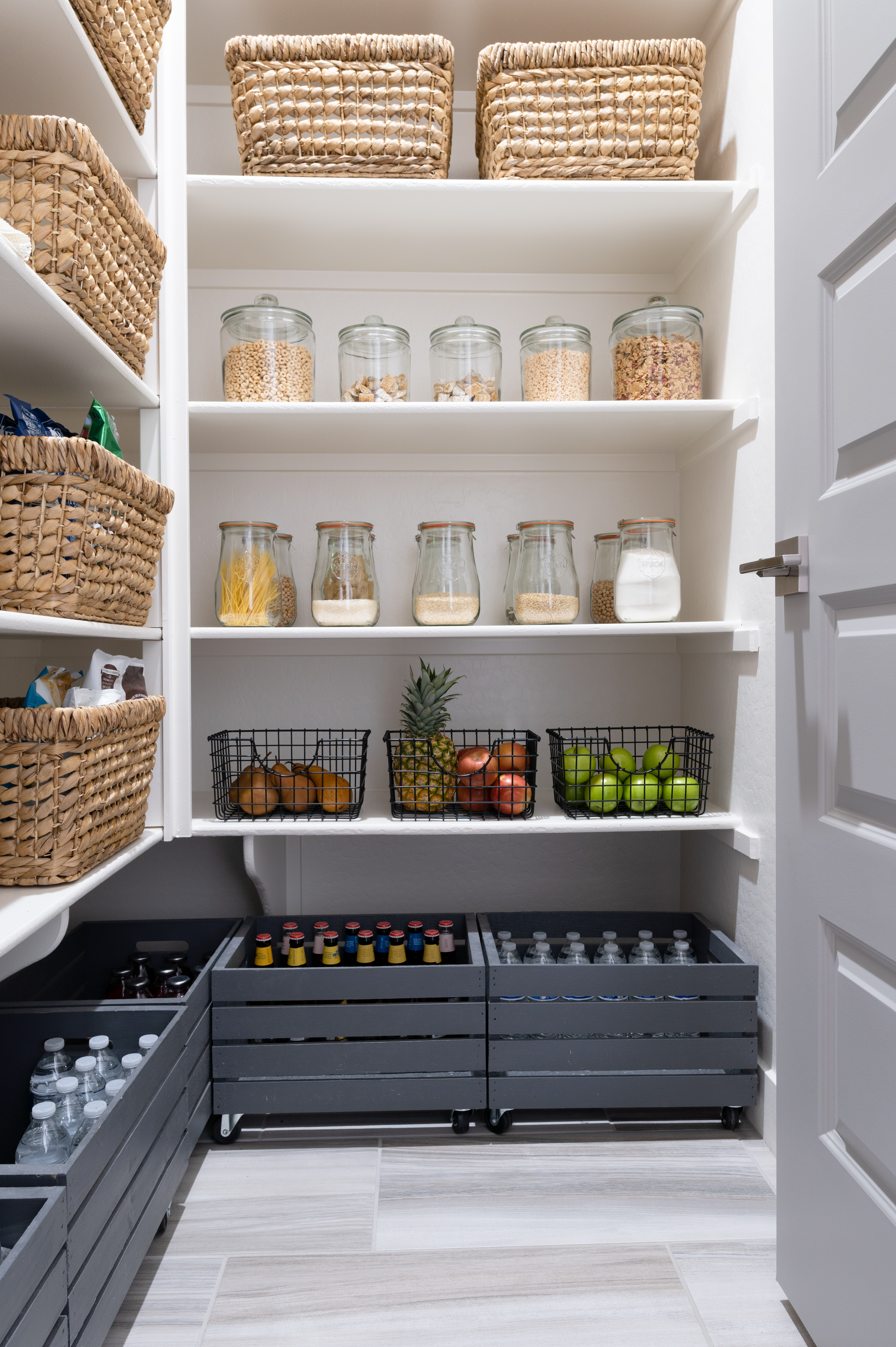 glass jars, black wire baskets and black wooden crates